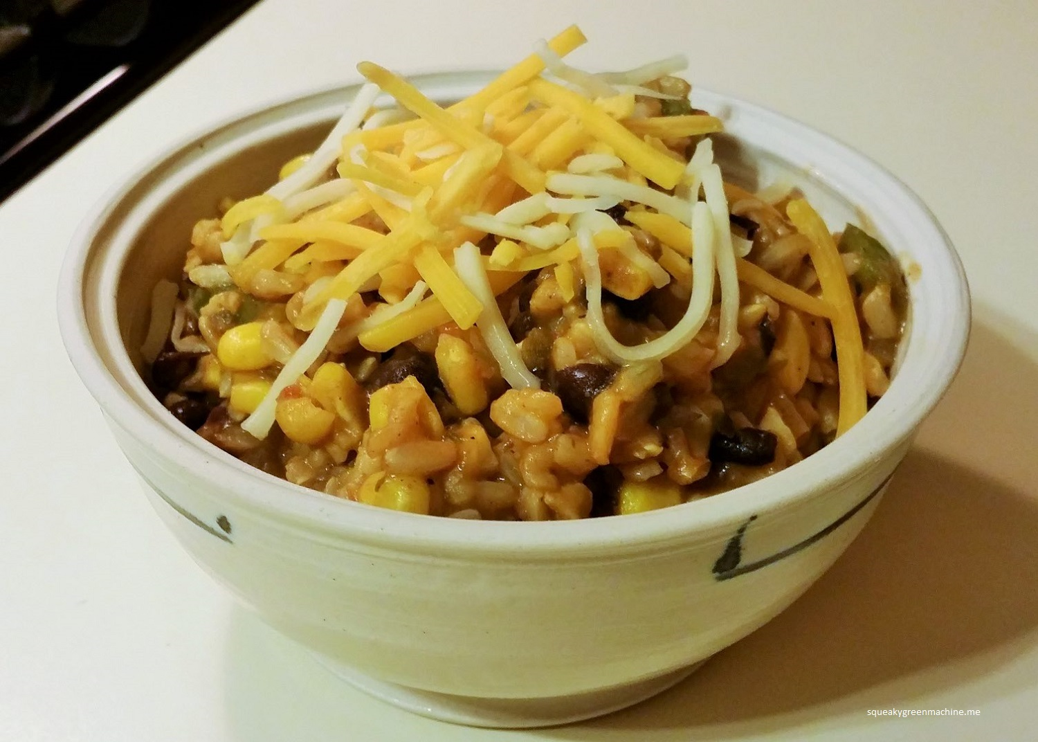 enchilada rice with cheese in a bowl